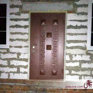 Кованые двери с жаткой