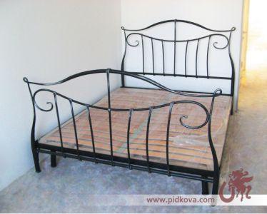 Стальные кованые быльца кровати